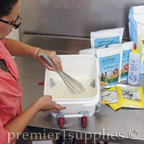 Mixing milk for orphan lambs