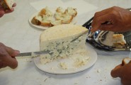 The cheese, paired with the wine and bread, was an incredibly delicious delicacy.
