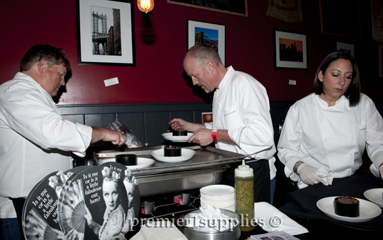 Chef Mark Hosack and his assistants plating for the judges table.
